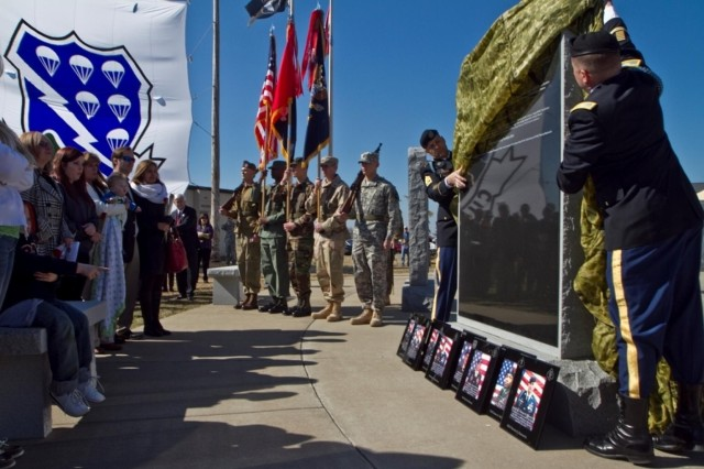 Col. Val C. Keaveny Jr. (right), commander of 4th Brigade Combat Team, 101st Airborne Division (Air Assault), with the assistance of Command Sgt. Maj. Franklin Velez, senior enlisted adviser for the 4th BCT, 101st Abn. Div., unveil the memorial featuring the names of the fallen Soldiers from the brigade's most recent deployment, March 13, 2014, at Fort Campbell, Ky.