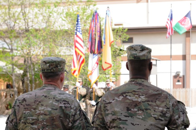 Brig. Gen. Donnie Walker Jr., 3d Sustainment Command (Expeditionary) commanding general and Command Sgt. Maj. Edward Bell, 3d Sustainment Command (Expeditionary) senior enlisted advisor, watch the color guard during the 3d ESC's uncasing ceremony April 23 at the New Kabul Compound in Afghanistan. The 3d ESC assumed responsibility from the 1st Theater Sustainment Command (Forward) and is charged with providing logistical and transitional support during their deployment. (U.S. Army Photo by Sgt. Justin Silvers)