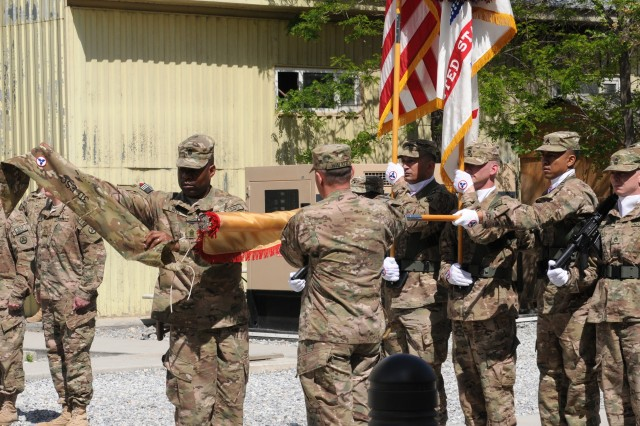 Brig. Gen. Donnie Walker Jr., 3d Sustainment Command (Expeditionary) commanding general, and Command Sgt. Maj. Edward Bell, 3d Sustainment Command (Expeditionary) senior enlisted advisor, uncase the 3d ESC colors during a ceremony April 22 at the New Kabul Compound in Afghanistan. The 3d ESC assumed responsibility from the 1st Theater Sustainment Command (Forward) and is charged with providing logistical and transitional support during their deployment. (U.S. Army photo by Sgt. Justin Silvers)