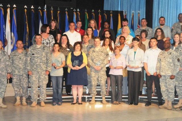 Volunteers with more than 250 hours, more than 1000 hours, and those selected as Volunteers of the Year pose with Hohenfels leadership during the Volunteer Recognition Ceremony on Hohenfels, April 23.