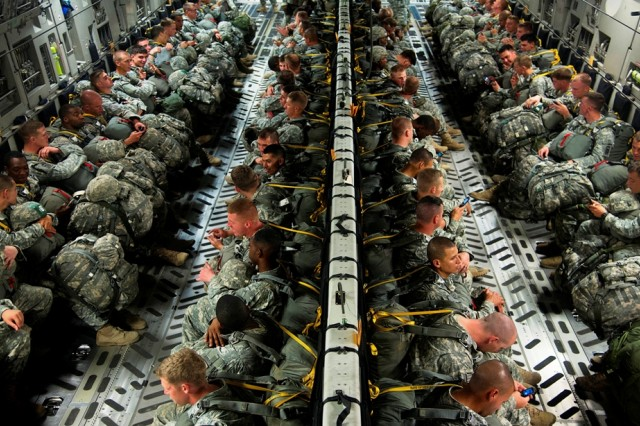 U.S. Army paratroopers with the 3rd Battalion, 319th Field Artillery Regiment, 1st Brigade Combat Team, 82nd Airborne Division, wait for takeoff in an Air Force C-17 aircraft on June 27, 2013, before an airdrop as part of Joint Operational Access Exercise 13-03 at Fort Bragg, N.C.  The Army's new Enroute Mission Command Capability will soon provide in-flight internet and mission command capabilities to elements of the 82nd Airborne Division that respond as part of the joint Global Response Force.