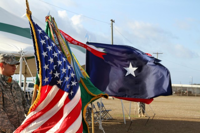 The colors fly over the parade field at Joint Task Force Guantanamo's Bulkeley Field during the 2228th and 747th Military Police Companies' transfer of authority ceremony, Friday, April 18, 2014.