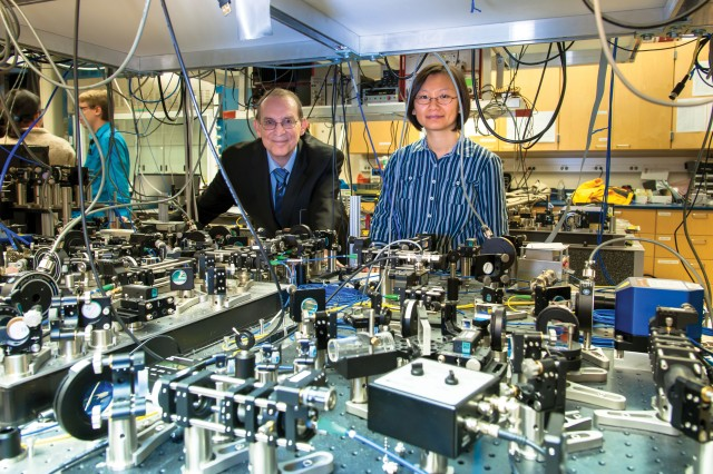 Army Research Laboratory scientists Ronald E. Meyers and Patricia J. Lee pose with gear designed to manipulate photons.