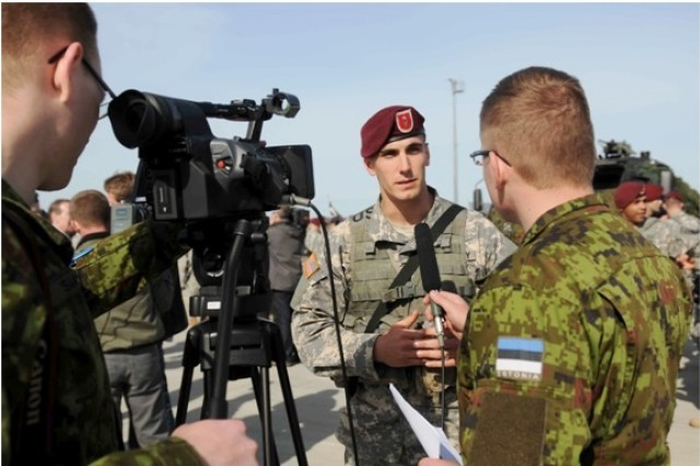 First Lt. Andrew Rodriguez, a platoon leader with Chosen Company, 1st Battalion, 503rd Infantry Regiment, 173rd Airborne Brigade, speaks to Estonian Soldiers after a ceremony commemorating new land forces exercises in Estonia, April 28, 2014. The paratroopers, who are part of a company-sized contingent, arrived here to begin exercises with Estonian troops in a series of expanded U.S. land forces training activities in Poland and the Baltic region scheduled to take place for the next few months and beyond. The multinational training fulfills the USAREUR strategic objective of preserving and enhancing NATO interoperability and demonstrates the United States' commitment to NATO Allies.