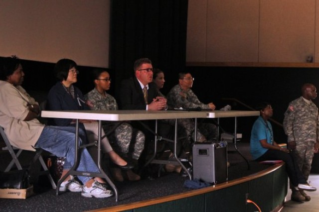 The 1st Signal Brigade Sexual Harassment/Assault Response Prevention (SHARP) panel hosts an open forum as part of the brigade's SHARP Stand Down April 18, 2014 at Yongsan's Multi-Purpose Training Facility. The Panel members [from left to right; Maj. Christine Robb (Panel Chaplain), Dr. Hyon Suk O (Panel Behaviorial Health Doctor), Cpt. Erika Johnson (Panel Sexual Assault Nurse Examiner) Mr. Matthew J. Haywood (Panel CID), Cpt. Lesley Ann Cruce (Panel Special Victims Advocate), Maj. Jack Ko (Panel Legal Representative)] answered questions from Soldiers of the 1st Signal Brigade. (U.S. Army Photo by Spc. Gregory T. Summers)