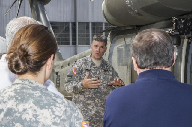 Chief Warrant Officer 5 George Kelly, command chief warrant officer, 3rd Combat Aviation Brigade, gives a brief on the UH-60 Black Hawk helicopter during a tour for the Bluffton/Hilton Head S.C. chapter of the Knights of Columbus on Hunter Army Airfield April 23. (Photo by Sgt. William Begley, 3rd CAB Public Affairs)