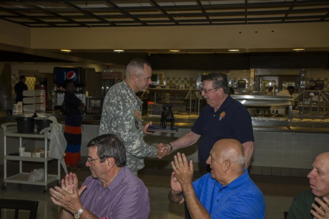 Col. John D. Kline, commander, 3rd Combat Aviation Brigade, hands a plaque to Bart Bubnell to thank the Knights of Columbus for their generosity during a tour for the Bluffton/Hilton Head S.C. chapter of the Knights of Columbus on Hunter Army Airfield April 23. (Photo by Sgt. William Begley, 3rd CAB Public Affairs)