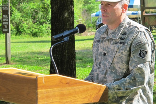 Lt. Col. William Burruss, Huntsville Center deputy commander, speaks to students during the Earth Day opening ceremony, April 24, 2014, at the Redstone Arsenal, Ala., Path to Nature.