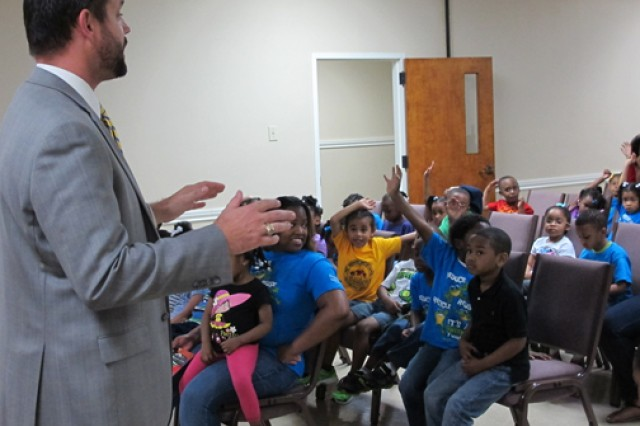 Huntsville Center project manager, Robert Mackey, speaks to First Missionary Baptist Church Child Development Center and Academy students during the school's Earth Day, event April 24, 2014.