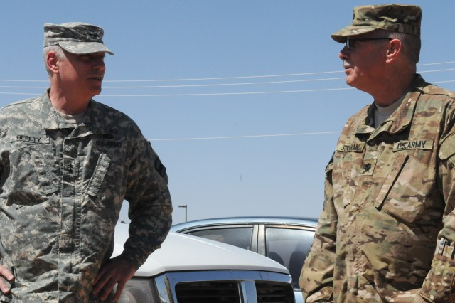 Maj. Gen. Bill Gerety, commander 80th Training Command (TASS) and Lt. Col. John Strahan, commander Security Forces Advisory Assistance Team, Detachment 82 during Gerety's visit to the unit at Fort Bliss Texas, April 24, 2014. Gerety and Command Sgt. Maj. Jim Wills, 80th TC senior enlisted leader, spent time with the Citizen-Soldiers before their deployment to Afghanistan in May 2014 to advise and assist the Afghan Border Police at Regional Command West near the Iranian border.