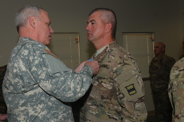 Maj. Gen. Bill Gerety, commander 80th Training Command (TASS), awards the Army Achievement medal to Staff Sgt. Ian T. Liebenberg, a medic assigned to Security Forces Advisory Assistance Team, Detachment 82, during an award ceremony at Fort Bliss, Texas, April 24, 2014. Leibenberg and fellow medic, Staff Sgt. Christopher Clay, created a five-day combat medic course that resulted in 100% Combat Life Savor qualification of all SFAAT DET 82 members. The 16 person team, 15 of whom are from various units across the 80th TC, is scheduled for deployment to Afghanistan in May 2014 to advise and assist the Afghan Border Police at Regional Command West near the Iranian border.