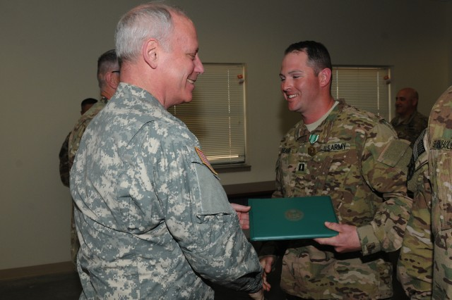 Maj. Gen. Bill Gerety, commander 80th Training Command (TASS), awards the Army Commendation Medal to Capt. Joseph Beard, executive officer Security Forces Advisory Assistance Team Detachment 82 during a ceremony at Fort Bliss, Texas, April 24, 2014. Beard received the award for planning and coordinating the training for SFAAT DET 82 during the team's pre-mobilization process. Beard is part of a 16 person team, 15 of whom are from various units across the 80th TC scheduled for deployment to Afghanistan in May 2014 to advise and assist the Afghan Border Police at Regional Command West near the Iranian border.
