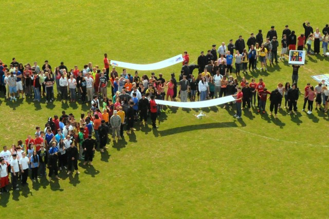 Hohenfels Military Community members highlight Autism Awareness with a human ribbon, April 24.