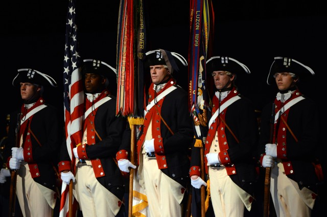 "The Army's Old Guard Fife and Drum Corps performs at a ""Salute from the Chief"" Twilight Tattoo, at Joint Base Myer-Henderson Hall, Va., April 28, 2014."