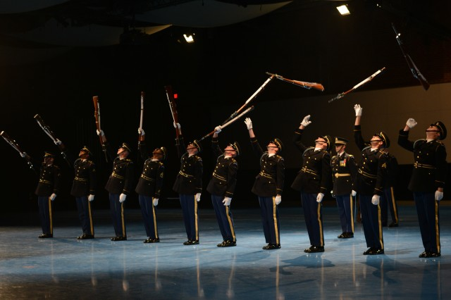 "Members of the Army's Drill Team showcase their precision moves at a special ""Salute from the Chief"" Twilight Tattoo, at Joint Base Myer-Henderson Hall, Va., April 28, 2014."