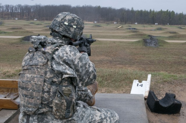 An Army Reserve Soldier fires at his pop-up targets in the kneeling position at the M4 rifle marksmanship range during the 412th and 416th Theater Engineer Commands' Combined Best Warrior Competition April 28 at Fort McCoy, Wis. Twenty-seven Army Reserve Soldiers are competing in this year's event from April 28 to May 2 and are vying for a slot to represent their Command at the next level. The top enlisted Soldier and NCO from each TEC will move on to compete at the U.S. Army Reserve Command's Best Warrior competition in June.