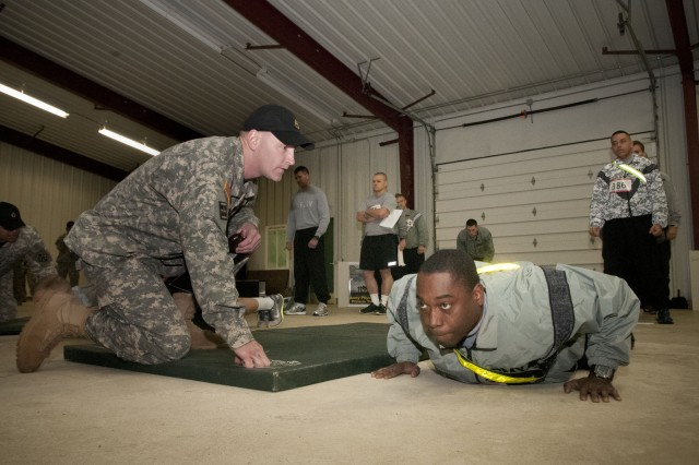 "Army Reserve Spc. Shaun Marshall, a combat medic and ""best warrior""competitor from the 207th Digital Liaison Detachment, 412th Theater Engineer Command, performs pushups during the Army Physical Fitness Test for the 412th and 416th TECs' Combined Best Warrior Competition at Fort McCoy, Wis., April 28."