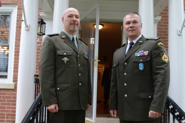 First Sgt. Jan Cmelik (left) and Command Sgt. Maj. Martin Holko, both from the Slovak army, pose for a photo in front of Sgt. Maj. of the Army Raymond F. Chandler III's house on Joint Base Myer-Henderson Hall, Va. They, and other foreign soldiers are attending the International Military Students Organization training at the U.S. Army Sergeants Major Academy at Fort Bliss, Texas.