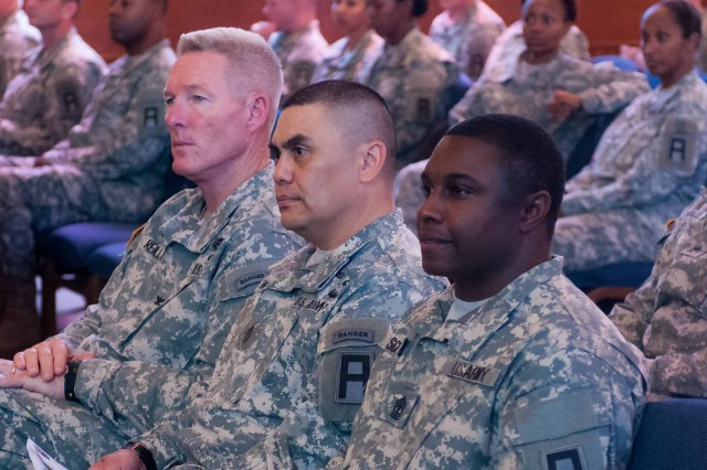 From left to right, Col. Gregory D. Reilly, DIVWEST chief of staff; DIVWEST Command Sgt. Maj. Patrick K. Akuna, Jr.; and 1st Sgt. Howard E. Scott, first sergeant of Headquarter and Headquarters Detachment, DIVWEST, listen on during the 106th Army Reserve Birthday celebration April 23, 2014.