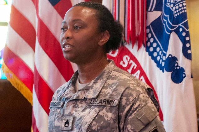 "Staff Sgt. LaKendra Johnson, noncommissioned officer-in-charge of the DIVWEST chapel, sings a laudable rendition of ""The Star-Spangled Banner"" during celebrations for the Army Reserve 106th birthday April 23, 2014."
