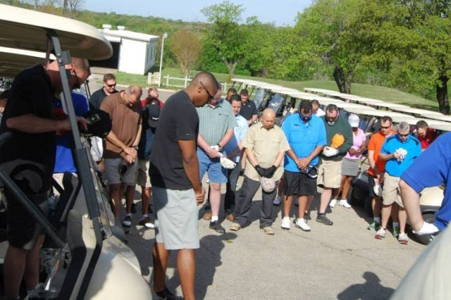 Soldiers and civilians from the 120th Infantry Brigade say a little prayer before they head out onto Fort Hood's Clear Creek Golf Course.