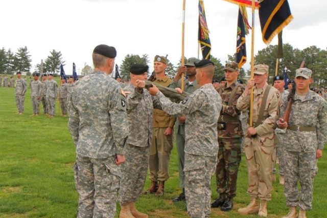 Maj. Gen. James C. McConville (left), commanding general, 101st Airborne Division (Air Assault), looks on as Col. Val C. Keaveny, Jr. (center), former commander of 4th Brigade Combat Team, 101st Abn. Div., and Command Sgt. Maj. Franklin Velez (right), command sergeant major of 4th BCT, 101st Abn. Div., case the brigade colors during the inactivation and relinquishment of command ceremony at the division parade field on Fort Campbell, Ky. April 25, 2014. (U.S. Army photo by Sgt. Justin A. Moeller, 4th BCT Public Affairs)