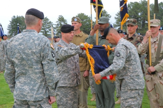 Maj. Gen. James C. McConville (left), commanding general, 101st Airborne Division (Air Assault), looks on as Col. Val C. Keaveny, Jr. (center), former commander, 4th Brigade Combat Team, 101st Abn. Div., and Command Sgt. Maj. Franklin Velez, command sergeant major of 4th BCT, 101st Abn. Div., fold the brigade colors prior to casing them during the inactivation and relinquishment of command ceremony at the division parade field at Fort Campbell, Ky., April 25, 2014. (U.S. Army photo by Sgt. Justin A. Moeller, 4th BCT Public Affairs)