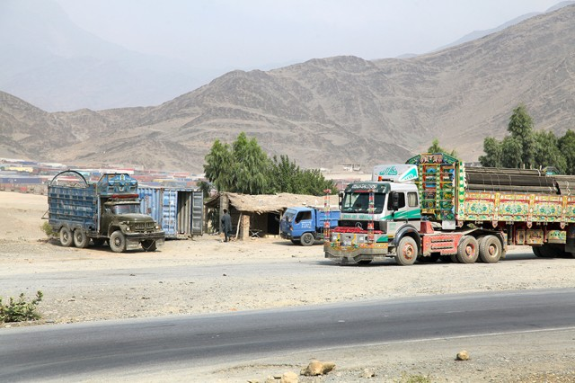 A delivery truck parks along the Khyber Pass outside of Forward Operating Base Torkham, Afghanistan. The heavily decorated truck is known as a jingle truck because of the sound it makes when in movement. Fewer jingle trucks are being used to transport supplies in the Afghanistan Transportation Network because they often require reconfiguration in order to properly load the assets, requiring additional time and resources and causing costly delays.