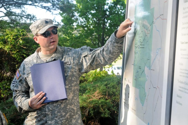 Staff Sgt. Bryan Tull, noncommissioned of the briefing section for the 314th Press Camp Headquarters, located in Birmingham, Ala., points out details on a map at the Chickamauga and Chattanooga National Military Park in Rossville, Ga. The Soldiers of the 314th took part in a long-standing Army tradition called the staff ride, where officers and senior non-commissioned officers tour a battlefield to understand higher level decision-making, tactics and leadership. (US Army photo by Staff Sgt. Paul Roberts/314th PCH, Released)