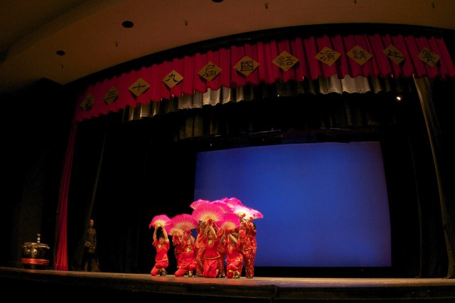 SAN FRANCISCO -- Traditional Chinese folk dancers and musicians entertain the more than 1,000 attendees and competitors while judges tally the scores and rank the competitors prior to the awarding of trophies at the 39th Annual Mandarin Speech Contest at the Lowell High School auditorium in San Francisco April 26. Thirty-five Defense Language Institute Foreign Language Center, Presidio of Monterey, students from all branches of the military made the trek north to test their skills and compete for honors. To learn more about the people and facilities of the Presidio of Monterey visit www.monterey.army.mil.