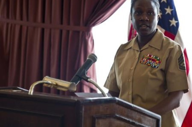 "Retired Gunnery Sgt. Annie E. Scott reads an anonymous statement from a victim of sexual assault during a Sexual Assault Prevention and Response luncheon April 25 at the Butler Officers' Club on Camp Foster. ""As a UVA, it was touching to have a victim come and speak to the leadership, the commanding generals and sergeant majors,"" said Scott, a Vallejo, Calif., native. ""It makes me feel that I am doing something bigger than myself, bigger than my command, when I help those that need that support."" Scott is an administrative specialist with Headquarters and Service Battalion, Marine Corps Base Camp Smedley D. Butler, Marine Corps Installations Pacific."