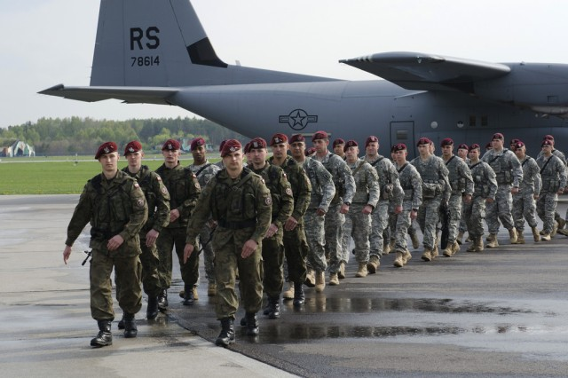 Paratroopers from U.S. Army Europe's 173rd Airborne Brigade, arrive at Swidwin Air Base, Poland, April 23, 2014, to begin a training rotation with the Polish army's 6th Airborne Brigade, one of the brigade's sister units. The Soldiers are here with their NATO allies in Poland, Estonia, Latvia and Lithuania as part of recently announced exercises to demonstrate U.S. commitment to the alliance and increase interoperability between forces.