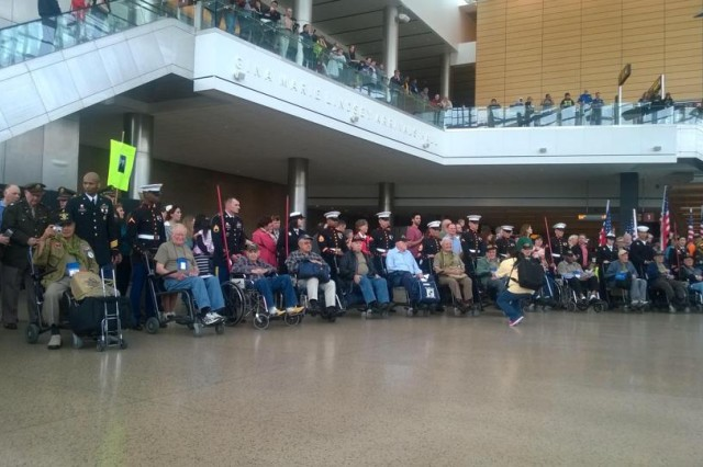 Current Soldiers, Sailors, Marines and other supporters attend a ceremony with World War II veterans at SeaTac Airport April 20, 2014. These veterans took part in an 'honor flight' that took 31 veterans on a three-day trip to the District of Columbia.