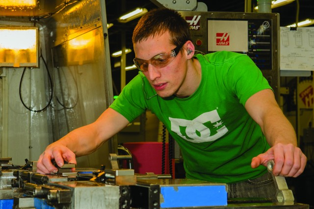 Preston Propes, a machinist at Tobyhanna Army Depot, programs and operates specialized machining equipment to produce metal parts for a number of military assets repaired at the depot.