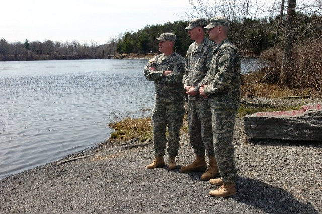 From left, Pfc. Matthew M. Phillips, Pvt. Trenton M. Brown and Spc. Christopher D. Grant revisit the boat launch from where they rescued a woman last week who had fallen out of a canoe on the Black River. All three Soldiers are members of the 10th Mountain Division (Light Infantry).