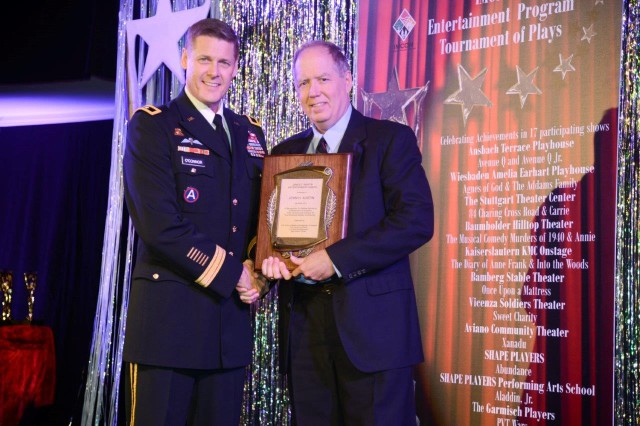 Jack Austin, right, from U.S. Army Garrison Bamberg, is presented the James T. Martin Entertainment Awards for Lifetime Service from Maj. Gen. John R. O'Connor during the Topper Awards Show and Ceremony April 26, 2014, in Kaiserslautern, Germany.