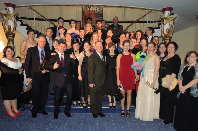 """Cast, crew and guests from the Franconia Military Community stand together for a photo at the 2014 IMCOM-E Topper Awards Show and Ceremony April 26 in Kaiserslautern, Germany. U.S. Army Garrison Ansbach performers received fifteen nominations and four wins for performances in """"Avenue Q,"""" as well as two special-acheivement awards for FMC individuals."""