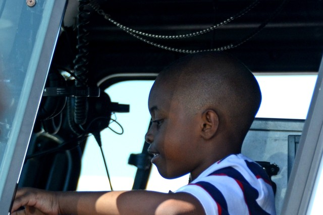 Ethan Thomas, 7, explores the inside of a fire truck during Fort Jackson's Month of the Military Child Family Fun Fair, April 26, 2014, at Patriot Park.