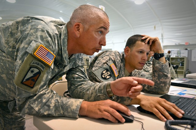 Soldiers from the 143rd Sustainment Command (Expeditionary) analyze logistics data during a command post exercise-sustainment at Fort Hood, Texas.