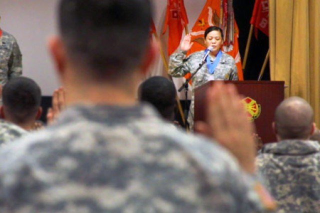 Schweinfurt's command sergeant major, Sgt. Maj. Thao Kamakahi-Watson, issues the Charge of the Noncommissioned Officer at USAG Schweinfurt's final NCO induction ceremony.