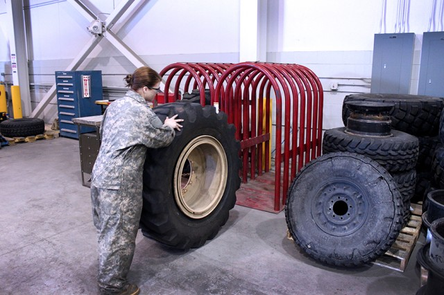 Pvt. Shelby Lee, 25th Brigade Support Battalion, 1st Stryker Brigade Combat Team, 25th Infantry Division, makes authorized tire repairs, saving the unit hundreds of thousands of dollars.