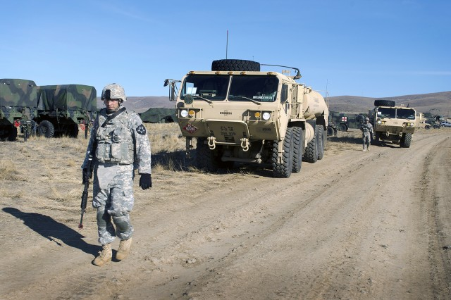 Soldiers from A Company, 296th Brigade Support Battalion, 3-2 Stryker Brigade Combat Team, 7th Infantry Division, prepare to conduct fuel operations for their brigade's six battalions at the Yakima Training Center, Wash.
