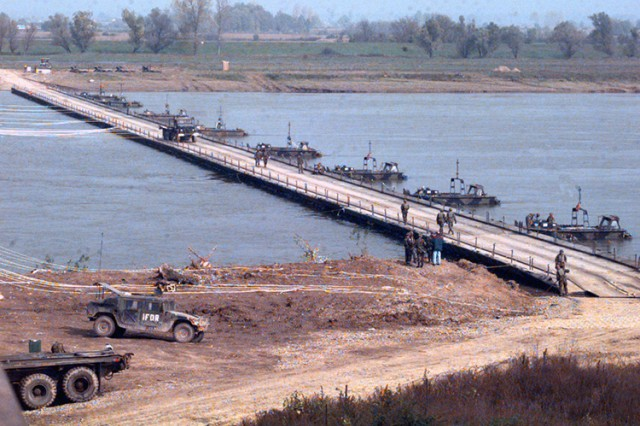 NATO and U.S. forces constructed a second bridge over the Sava River in December 1995 to accommodate rising civilian and military traffic.