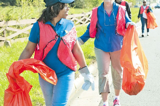 ServiceMaster employee Dianne Anderson and owner Jane Gandee pitch in during a Route 1 Cleanup event hosted by Fort Belvoir and the Mount Vernon-Lee Chamber of Commerce,  Saturday.