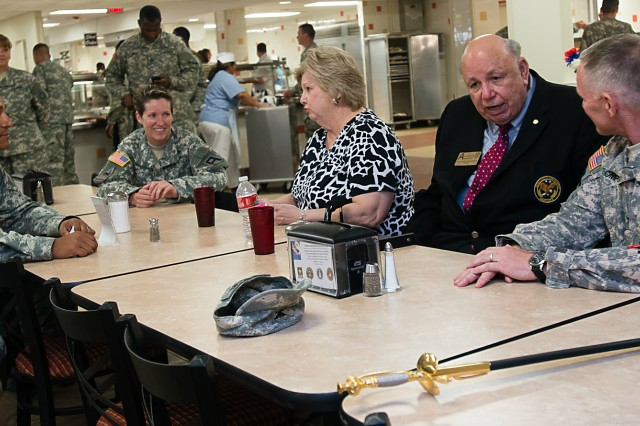 Olin Brewster, Texas U.S. Army Reserve Ambassador, talks with Col. Robert Thompson, commander of 1st Brigade, Southern Division, 75th Training Command, (at the right) during the 106th U.S. Army Reserve birthday Celebration April 23, 2014 at McGregor Range, N.M., while Anne Brewster, wife of Olin Brewster, chats with Col. Raul Gonzalez, 5th Armored Brigade commander, and Col. Carolyn Birchfield, 402nd Field Artillery Brigade commander (at the left).