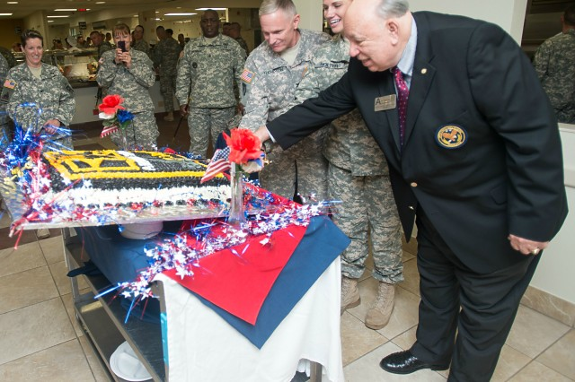 Olin Brewster (right), Texas U.S. Army Reserve Ambassador, cuts the U.S. Army Reserve 106th birthday cake with Col. Robert Thompson (left), commander of 1st Brigade, Southern Division, 75th Training Command, and Staff Sgt. Heather Holter (center), 5th Armored Brigade Headquarters and Headquarters Company training non-commissioned officer, during the ceremonial cake-cutting celebration at McGregor Range, N.M.
