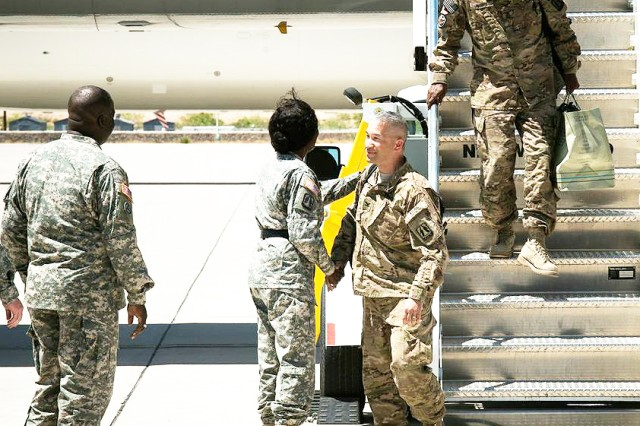 "Brig. Gen. Kaffia ""Belle"" Jones, 335th Signal Command (Theater) deputy commanding general, greets Col. Stephen Hager, Soldier from 335th SC (T), as he steps off the plane at Biggs Army Airfield at Fort Bliss, Texas, April 20. Hager and the 335th Soldiers just returned from a yearlong deployment to Afghanistan. (Photo by Sgt. 1st Class David Parish, 5th Armored Brigade, Division West Public Affairs)"