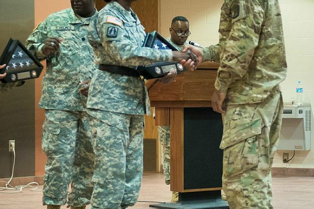 "Brig. Gen. Kaffia ""Belle"" Jones, 335th Signal Command (Theater) deputy commanding general, congratulates Capt. Randy Chambers, Soldier from 335th SC (T), on a successful completion of a yearlong deployment during the Welcome Home Ceremony at Bigg Army Airfield at Fort Bliss, Texas, April 20. Jones presented first-time deployers with a Welcome Home Warrior Citizen plaque. Those with multiple deployments, she presented them with certificates of appreciation. (Photo by Sgt. 1st Class David Parish, 5th Armored Brigade, Division West Public Affairs)"