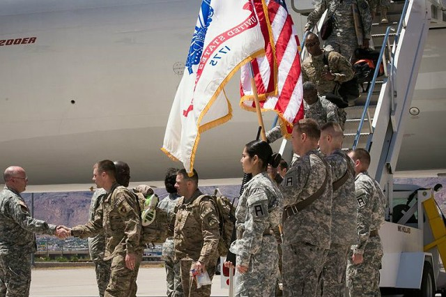 "Soldiers from the 335th Signal Command (Theater) deplane on U.S. soil at Biggs Army Airfield on Fort Bliss, Texas, April 20 for the first time since deploying last April to Afghanistan in support of Operation Enduring Freedom. Brig. Gen. Kaffia ""Belle"" Jones, 335th SC (T) deputy commanding general, greeted the Soldiers and shook hands one by one as they filed out of the aircraft. (Photo by Sgt. 1st Class David Parish, 5th Armored Brigade, Division West Public Affairs)"