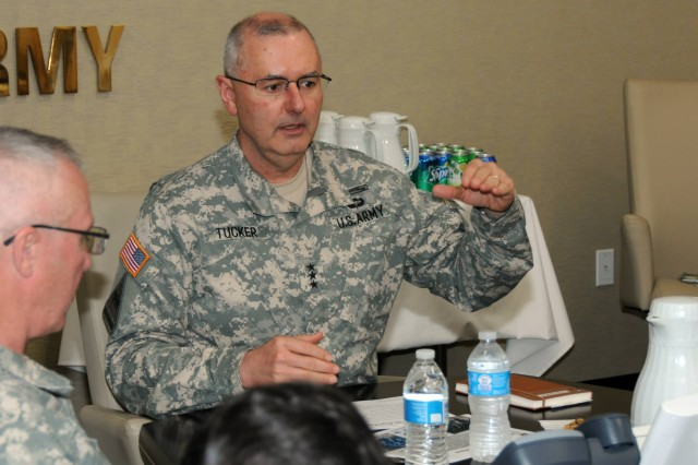 Lt. Gen. Michael S. Tucker, First Army commanding general, addresses Civilian Aides to the Secretary of the Army in the Hodges Conference Room in First Army headquarters on April 25. In attendance were CASAs Sam Kupresin, Tracy Beckette, Paul Lima, and Dan McGowan.